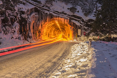 Tunnel at Yosemite (lgflickr1) Tags: winter night lowlight snow california yosemite road movement nationalpark vacation tunnel headlights glow orange red white icicles trails lighttrails