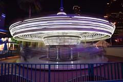 Hold on! (terri_mcclanahan) Tags: longexposure motion colors lights nightscene merrygoround trailinglights