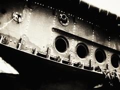 Scrapyard (J.C. Moyer) Tags: blackandwhite airplane wing scrapyard scrapheap