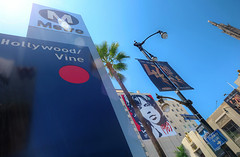 Hollywood & Vine (Non Paratus) Tags: sky sun signs palms subway la losangeles metro sunny hollywood banners redline 1735mmf28d metrorail lampposts hollywoodandvine metroriderla