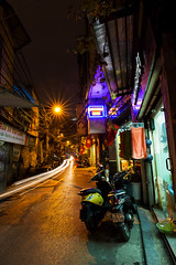 The Nam 002 (Cycle the Ghost Round) Tags: lighting street city longexposure urban orange yellow asian gold alley asia vietnamese glow moody gritty vietnam hanoi sodiumvapor lighttrail