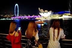 Let's guess are three of them all busy with their cell phones? #singaporeriver  #sonyA6000 #sigma30f14 (boston_yuki) Tags: singaporeriver sigma30f14 sonya6000