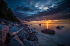 wood on stone (Andy Buchholz) Tags: longexposure sunset sea summer sky nature water stone clouds nikon rocks balticsea rgen lohme nikond7200
