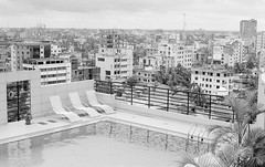 Hotel roof, Bangladesh, 2016 (dtenisoncollins) Tags: 2016 400 bangladesh hc110b hp5 k1000 iso400 ilford film pentax believeinfilm filmisnotdead ishootfilm travel epson v550 documentary street analog asia southasia pool swimming sunbed roof view water