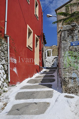 Street in the mountain village (Ivanov Andrey) Tags: house street village ascent descent city quarter surface wall corner stone stones window door red white sky cloud blue walk travel architecture peloponnese greece
