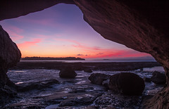 sunset arch (nzfisher) Tags: sunset sea newzealand sky seascape color colour clouds canon landscape twilight rocks colorful arch sundown dusk shoreline formation auckland shore 24mm colourful bucklandsbeach musickpoint