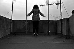 **Escaping leap (Despina Titoni) Tags: portrait urban blackandwhite bw woman selfportrait black rooftop girl weather female hair grey jump shoes break photographer escape cloudy young free plan greece jacket short taylor trousers chuck leap allstars antennas escaping nikond3100