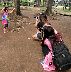 Posing for the Cameras (mikeeliza) Tags: park pink trees opportunity woman brown black cute green nature girl grass leaves hair asian photo long child dress adult little philippines photographers posing cameras backpack manila pinay filipina straight childphotography centerofattention womenphotographers posingforthecameras photoevent mikeeliza