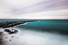 The Calm Coastline (DanielWaschnigPhotography) Tags: ocean longexposure travel blue sea sky italy cloud white beach nature water beautiful landscape coast movement aqua mediterranean turquoise scenic aquamarine calm coastline mediterraneansea sanremo waterscape secenic
