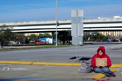 Homeless and Pregnant (Philip Osborne Photography) Tags: street red girl sign 50mm hoodie homeless pregnant begging immigrant f17 pentaxa
