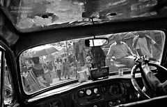 A Sigh for Kolkata (Jobopa) Tags: street city travel people urban blackandwhite bw india streets monochrome car way asian outdoors drive mirror cabin asia driving hand cab taxi indian transport rep citylife cities documentary pointofview indoors direction transportation sigh commute vehicle destination commuter driver commuting passenger dailylife ambassador oriental kolkata bustle calcutta steeringwheel commuters taxicab reportage asiatic chaotic bengali westbengal calcuta 2011 indoorpointofview asighforkolkata