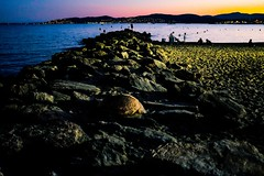 Beach after sunset (s.razura) Tags: travel sunset people seascape france mountains beach sand rocks europe mediterranean fujifilm southoffrance europeonflickr