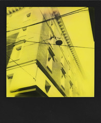 Faade (ale2000) Tags: windows detail building geometric lines yellow architecture analog frombelow lookingup giallo wires bologna instant analogue parallels faade impossible yellowandblack i1 gialloenero thirdmanrecords