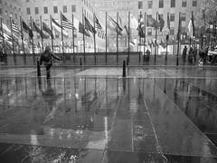 Untitled (C@mera M@n) Tags: nyc newyorkcity blackandwhite ny newyork reflection monochrome rain outdoors us unitedstates manhattan rockefellercenter places newyorkcityphotography