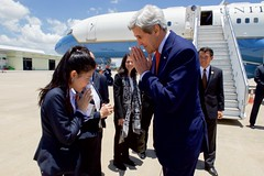 Secretary Kerry Bows as he Greets a Laotian Protocal Officer at the Wattay International Airport in Vientiane (U.S. Department of State) Tags: johnkerry laos asean