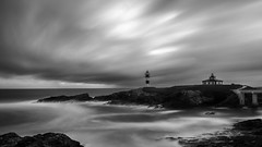 Lighthouse II (Con las manos en los bolsillos) Tags: lighthouse faro seascape sea sunset beach water ocean sky clouds rocks sunrise travel summer longexposure waves sun coast fujifilm fujinon fuji xf1024 blancoynegro blackandwhite paisaje landscape blackandwhitelandscape black white
