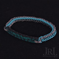 A little test piece I am wearing this weekend to see how it holds up. GITD Aqua slim line sidecut carbon fiber with light blue rubber rings & titanium bracelet. Ive got more like this with other colors Im going to be playing with.  or :thumbsdow (JenniferRay.com) Tags: ray jennifer jewelry carbon custom fiber exclusive paracord jrj instagram