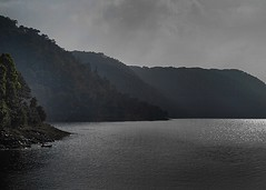 Solitude !!! (Lopamudra !) Tags: lopamudra lopamudrabarman lopa meghalaya khashi reservoir mist darkness hills lake loch shillong landscape waterscape enigmatic mysterious mountains mountain water india clouds tree light shade shadow boat man journey