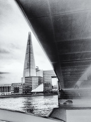 The Shard from below London Bridge (Woodacus) Tags: light sky blackandwhite cloud london water monochrome mobile thames architecture buildings hospital londonbridge river point concrete grey mono soft cityscape different walk framed under grain angles below underneath viewpoint shard alternative thamespath upwards waterscape iphone onelondonbridge silverefexpro2 iphone5s iphone5sbackcamera412mmf22