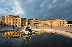 Schnbrunn Palace (Philipp Klinger Photography) Tags: schnbrunn vienna wien morning travel blue trees windows light vacation sky people panorama sculpture orange cloud holiday storm reflection tree window water fountain yellow stone architecture clouds facade sunrise reflections austria sterreich nikon warm europa europe angle cloudy stones no widescreen brunnen wide warmth stormy palace symmetry well cobble symmetrical kaiser schloss 169 philipp d800 klinger habsburg reflectiosn empereor habsburger