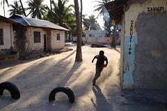 (Ilia Izotov) Tags: africa boy shadow tanzania running palmtree zanzibar jambiani