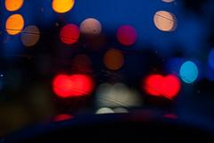 Blurry Sight (Maxi Winter) Tags: auto morning car rain 50mm lights nightshot traffic bokeh pluie voiture rushhour windshield streaks verkehr regen steeringwheel lumières lichter morgens trafic schlieren lenkrad parebrise volant windschutzscheibe lematin stries heuredepointe