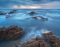 Mornings Promise (Peter Knott) Tags: ocean longexposure morning blue sea seascape water rock sunrise landscape dawn coast aperture rocks surf waves cloudy shoreline australia olympus wash shore nsw coastline zuiko gitzo em1 1260mm microfourthirds rrsbh40 gt2542l