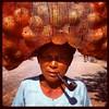 Pipe and sack of onions (Lil [Kristen Elsby]) Tags: portrait topv2222 square asia southeastasia burma squareformat myanmar iphone rakhine sittwe rakhinestate iphoneography instagram instagramapp