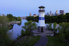 Spring at Boom Island (Sam Wagner Photography) Tags: park bridge blue sunset summer lighthouse reflection public skyline night river mississippi island golden spring twilight downtown cityscape dusk magic minneapolis boom clear hour hennepin