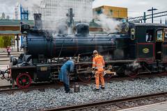 Oil those wheels (paulius.malinovskis) Tags: man beautiful train work spring sweden sony steam explore crew uppsala oil scandinavia agathachristie uppland olftimes