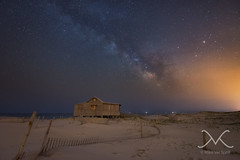 Drifting Into The Light (Mike Ver Sprill - Milky Way Mike) Tags: ocean longexposure sea sky beach stars landscape star timelapse newjersey sand alone nightscape unique fineart nj photograph le astrophotography astronomy universe heights jerseyshore seashore cosmos lightpollution ibsp 1530 seasidepark gazer gazers islandbeachstatepark 1424 greatphotography boatlights milkywaygalaxy nikond600 nikond800 michaelversprill mikeversprill milkywaymike judgesshack neildegrastyson