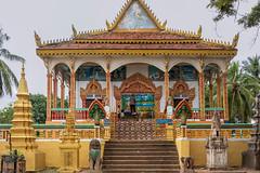 A-Buddhist-shrine-at-Kampong-Phluk-get-a-new-coat-of-paint,-Cambodia (tmeallen) Tags: travel two boys painting mural colorful cambodia artist culture guarding nagas freshpaint buddhistshrine kampongphluk 7headedcobras