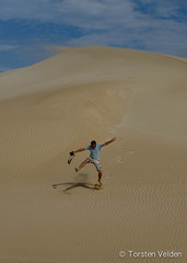 Runner in Dunes (Torsten Velden) Tags: travel blue sky holiday clouds landscape person one sand flickr cloudy dunes stock getty southaustralia portlincoln