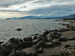 Sunset Beach - Vancouver (phil_king) Tags: bay beach british canada coast coastline columbia dusk english evening mountains ocean pacific rocks sea seaside ships sunset vancouver water