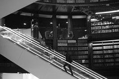 That Escalated Quickly (pigpogm) Tags: people blackandwhite monochrome up person birmingham photos library escalator unprocessed birminghamlibrary voigtlander40f14 mxpp