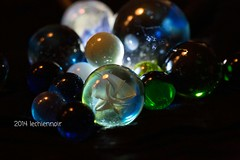 You are never too old to play with marbles. (LeChienNoir) Tags: light playing macro home glass colors canon happy licht marbles glas torchlight spelen blij kleuren knikkers 100mm28macro canonnl lantaarnlicht lechiennoir lechiennoirnl