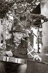 Country Diet (selmanphotos) Tags: california street family blackandwhite music hat statue saw downtown guitar streetphotography downtownsantacruz streetcollection