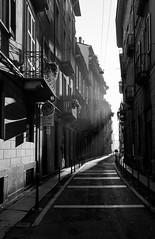 Milano, Via Cerva (lothar1908) Tags: street light shadow bw canon 3d strada milano ombra frog nebbia inverno luce biancoenero winterlight domenica prospettiva selciato viacerva canoneos5dmarkiii ef2470mmf28liiusm