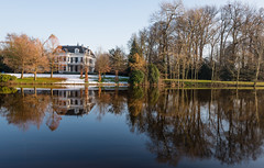 Historic waterfront villa (RuudMorijn-NL) Tags: park travel blue trees winter sky white house snow cold reflection home nature water beautiful grass architecture rural river garden season landscape real outside outdoors for reflecting bomen europe frost exterior forsale estate waterfront outdoor sale snowy mark country sneeuw scenic sunny nobody landmark structure reflected restored mansion huis dag relaxation breda majestic residential idyllic kale tranquil architectuur landschap zonlicht weerspiegeling reflectie zonnige rivier windless woning spiegeling slateroof tekoop zonnig waterkant winterdag wateroppervlak spiegelglad valkrust ulvenhoutselaan2