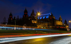Kelvingrove Art Gallery & Museum (GenerationX) Tags: road red grass yellow museum architecture night circle stars lights scotland exterior artgallery unitedkingdom streetlights glasgow scottish neil flags lighttrails kelvingrove clearsky barr argylestreet