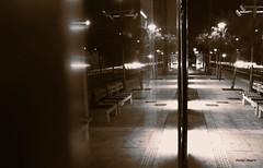 reflections on the last tram (mare_maris off) Tags: street door city winter urban blackandwhite bw white black window glass reflections lights mirror noche strada nightshot floor chairs image perspective streetphotography tram nopeople surface terminal explore greece lane bancos manual illusions voula benches reflexions cristal riflessi stazione tramway reflets notte glas estacin sepiatone reflejos sillas reflexionen vitre f63 mirroring withoutflash reflexiones tramstation tranva  terminalstation transparences riflessioni  nachtmodus rflexions strasenbahn  mainlane modonocturno   modenuit thelasttram nikond5100 january2015 maremaris vetroditram emtystation