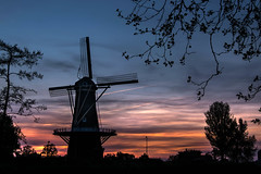 Sunset on Liberty-day in Holland (marielledevalk) Tags: trees sunset holland netherlands windmill dutch clouds evening