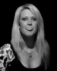 Give the camera some love . . (Oliver Leveritt) Tags: oliverleverittphotography woman candid blackandwhite monochrome nikond90 afsdxvrnikkor18200mmf3556gifed flash speedlight sb800 garyfonglightspherecloud offcameraflash cls nikoncls nikoncreativelightingsystem
