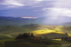 Flashes of light (Agrippino Salerno) Tags: morning travel trees light italy clouds sunrise canon countryside hills tuscany cypress valdorcia sanquiricodorcia countryfarm poderebelvedere agrippinosalerno