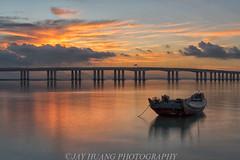 Xiamen Sunrise (Jaykhuang) Tags: ocean china bridge reflection clouds coast boat burn xiamen fujian typhoon jimei surnise jayhuangphotography
