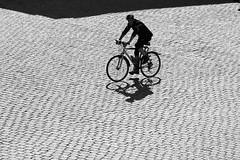 I want to ride my bicycle ... (Wackelaugen) Tags: bicycle person silhouette biker cyclist bicyclist shadow driving pavement cobble cobblestone patterns solitude stuttgart germany canon eos photo photography wackelaugen googlies black white bw blackwhite blackandwhite mono