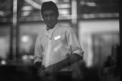 Could Georgia be on your mind ? (N A Y E E M) Tags: staff kitchen candid portrait ramadan afternoon lobby hotel radissonblu chittagong bangladesh glass panel reflection bokeh availablelight indoors