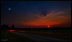 Impossible sunset (WibbleFishBanana) Tags: moon sun sunset lighttrail fassberg germany