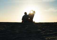 Catching the Sun (thanatosst) Tags: sunset beach silhouette couple hugs love sweet paradise