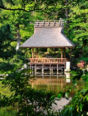 Thatched pavilion over pond (the.bryce) Tags: japan hiroshima shukkeiengarden